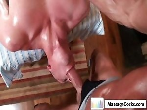 Horny gay dude gets a dildo shoved in his ass and nibbles on his masseurs cock
