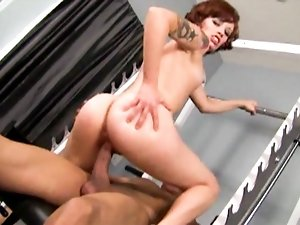 Redhead tattooed slut rides on hard cock